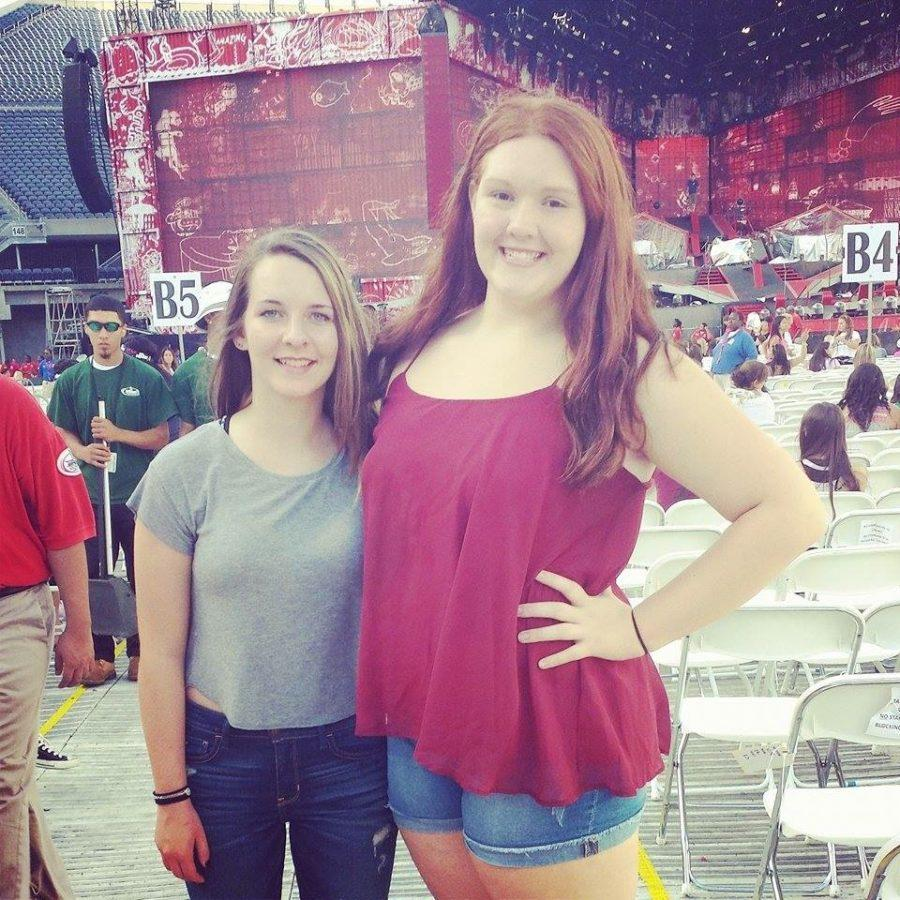 Sophomore Madeline Skiles (Right) and friend pose at their seats next to the stage where One Direction performed. Skiles and friend joined over 100,000 fans (AKA