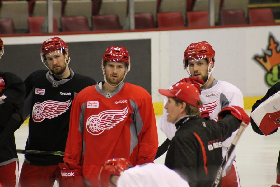 (Left to Right) Niklas Kronwall, Darren Helm and Brendan Smith all zoned in on coach Mike Babcock.