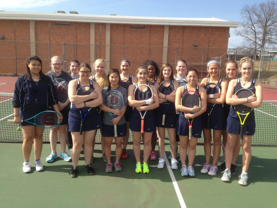 Loy Norrix Womens Tennis Team in 2014. Athletes hit the courts for practice as spring arrives. Photo Credit: Art Williams