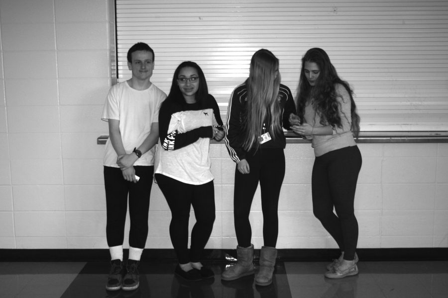 Loy Norrix students Brandon Whitmore, Maileen Bugnaski, Isabelle Whalen and  Courtney Richardson wear leggings in protest to the dress code. The dress code has recently been under evaluation. Photo Credit / Felippe Santos