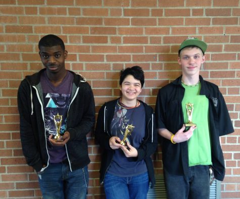 To  the  far  left  is  second  place  winner,  sophomore  Khaleel  Cook.  In  the  middle  is  third  place  winner  Emily  Wigler.  On  the  far  right  is  first  place  winner  Daniel  Coffee. Photo Credit / Taylor Timmerman