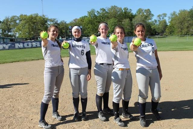 (Left to right) Seniors Katie Srodes, Paige Blinkiewicz, Hannah Roberts, Briana Kent and Jordan Liddle hold their balls. Photo Credit / Kristi Johnson
