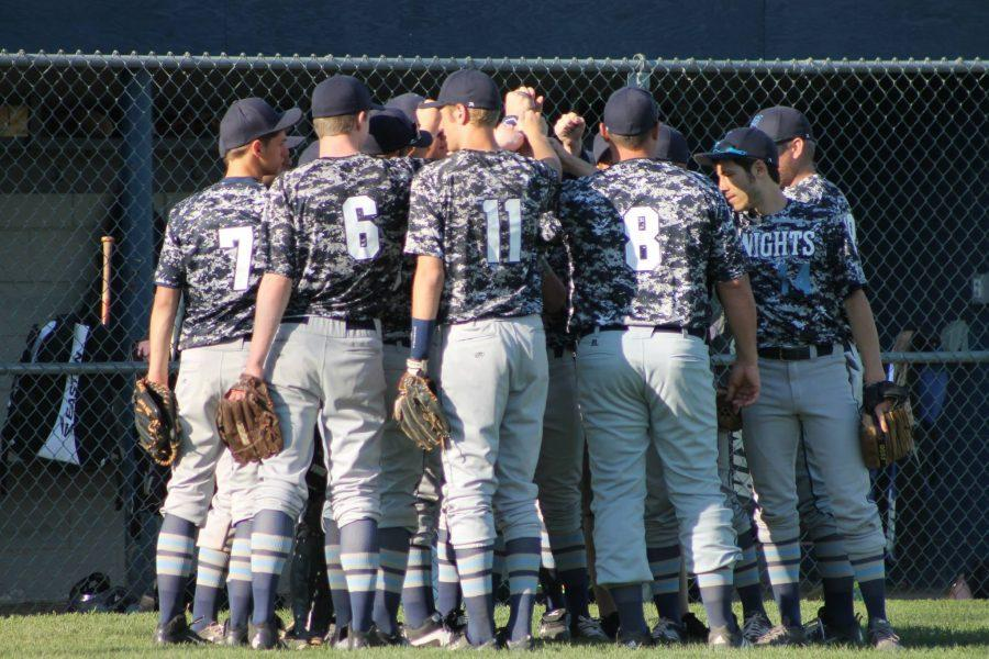 Varsity Baseball Coach Brian Neel wearing jersey number 8, leads his team in a breakdown. Neel resigned after 20 years of coaching and plans to help out when he can. Photo Credit: Lauren Johnson