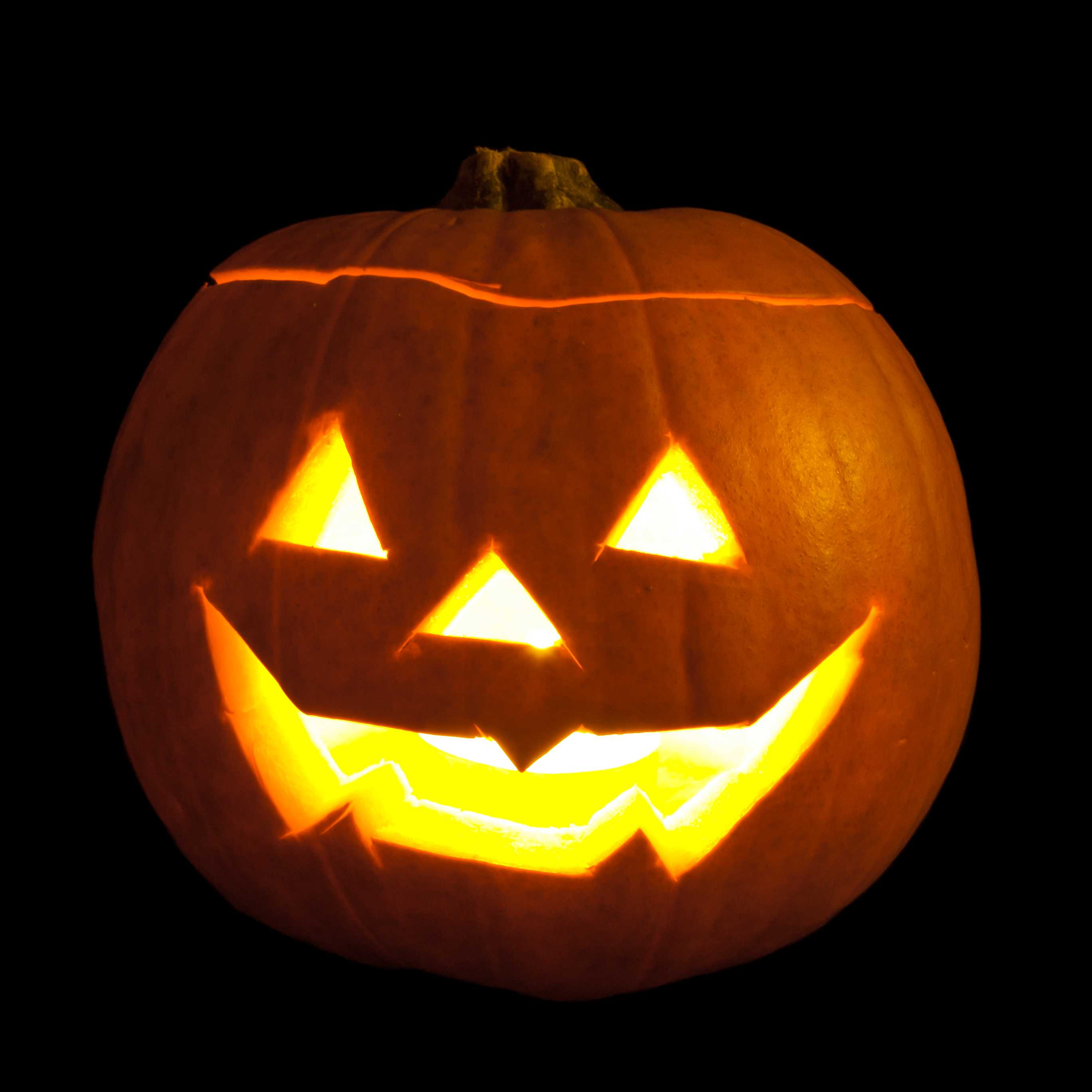 Jack-o'-lantern carved from pumpkins and lit with tea lights