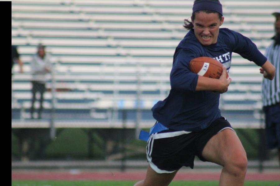 Julie Zabik runs the football for the seniors.