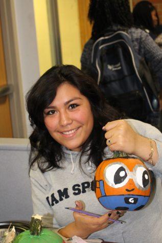 Students Paint Pumpkins for the Community