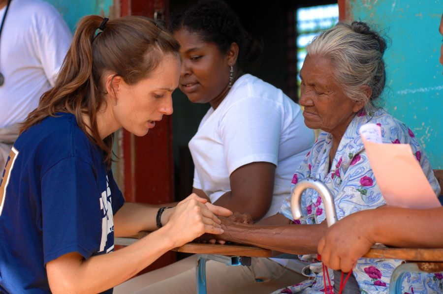 080815-N-7540C-148PUERTO CABEZAS, Nicaragua (Aug.15, 2008) Project Hope volunteer Sara Joyce, embarked aboard the amphibious assault ship USS Kearsarge (LHD 3), examines the hand of an elderly Nicaraguan woman at a medical clinic at Juan Comenius High School during a Continuing Promise 2008 humanitarian assistance project. Kearsarge is the primary platform for the Caribbean phase of Continuing Promise, an equal-partnership mission involving the United States, Canada, the Netherlands, Brazil, Nicaragua, Panama, Colombia, Dominican Republic, Trinidad and Tobago and Guyana. (U.S. Navy photo by Mass Communication Specialist 1st Class David G. Crawford/Released)