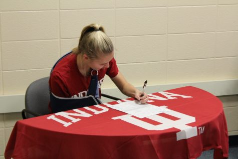 Grace Labadie signs her four year commitment to Indiana. She has played varsity soccer for the Knights since freshman year. Photo Credit / Chris Hybels