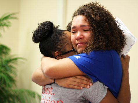 Haven Johnston embraces her good friend Maia Greer with happy tears in her eyes. They have both committed to different colleges and are very excited for each other. Photo Credit / Caitlin Commissaris