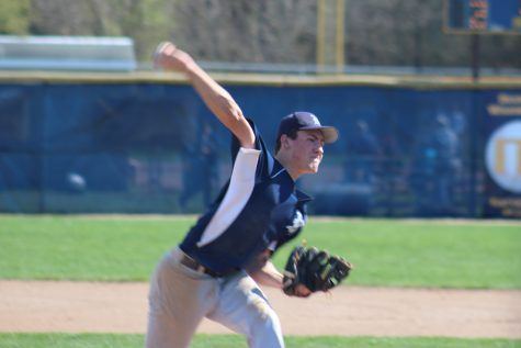 Rob Pincus's junior pitcher, James Rinehart throws in the third inning against Mattawan High School on May 4th. James is one of many pitchers on Loy Norrix Baseball team. Norrix finished the game with a 5-2 loss Photo credit / Jonathan Palone