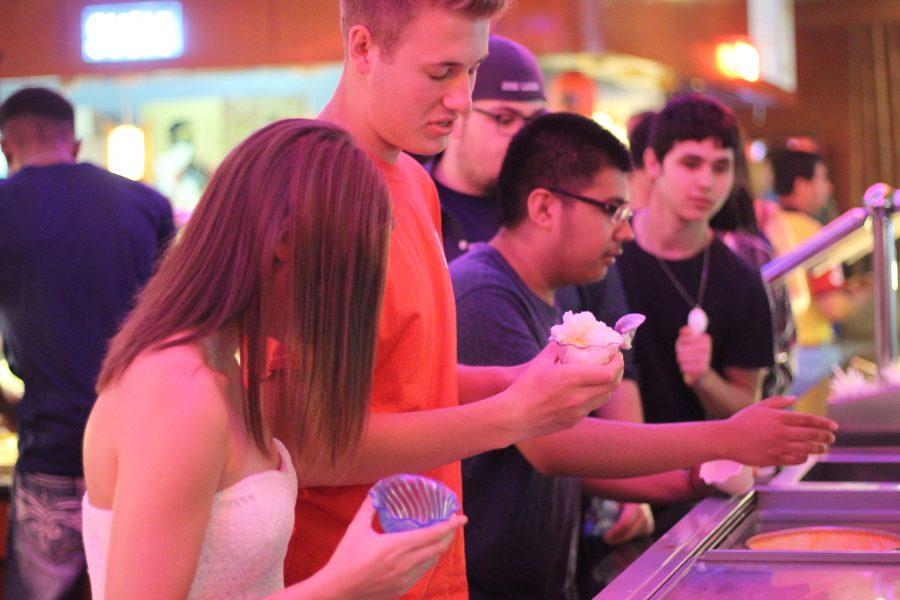 Seniors crowd around the ice cream bar. Photo Credit / Abby Farrer