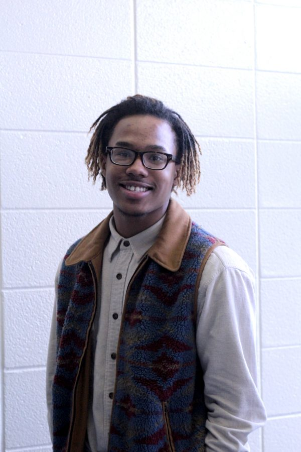 Loy Norrix senior, Jonathan Wilson, smiles for a photograph while talking about his passion for music. His music has made him a popular artist around Loy Norrix. Photo Credit / Bailey Handley