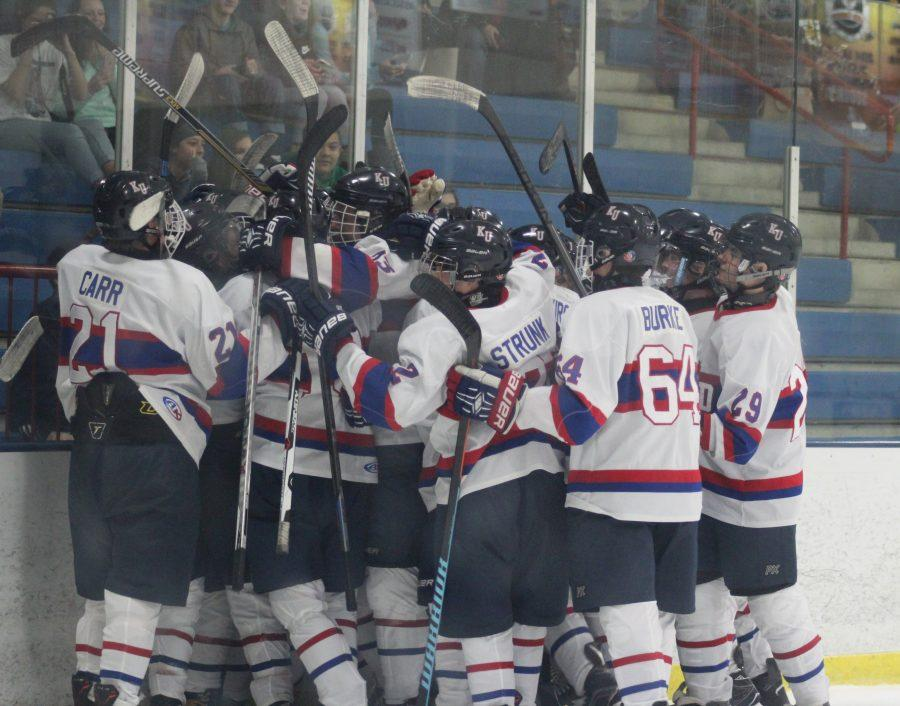 Kalamazoo United hockey team celebrates after Captain Jacob Remelius scores a game winning goal with 0.3 seconds left in overtime.  This win extended their win streak to twelve games. Photo Credit / Bailey Handley