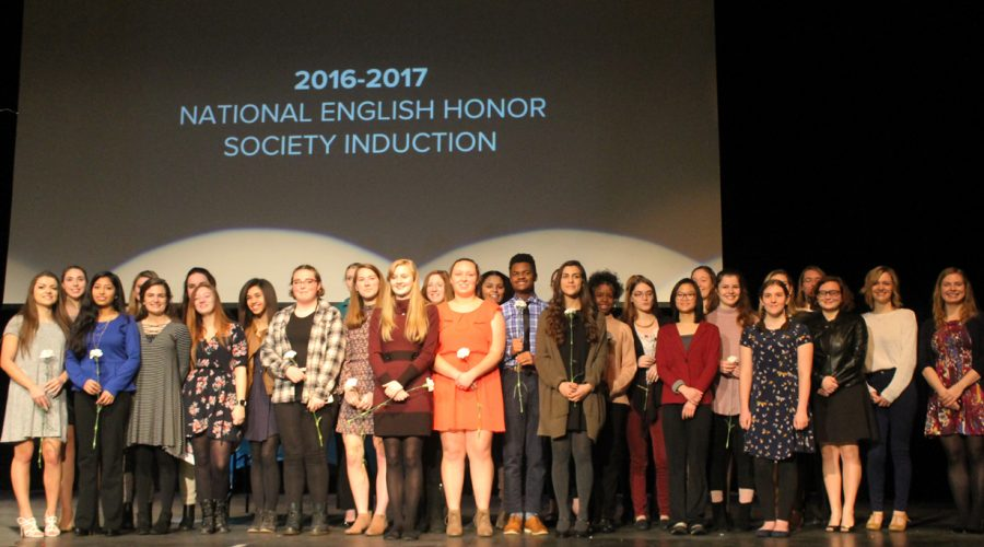 All the members stand on the stage at Loy Norrix to congratulate and recognize the newcomers. Photo Credit / Olivia Mears