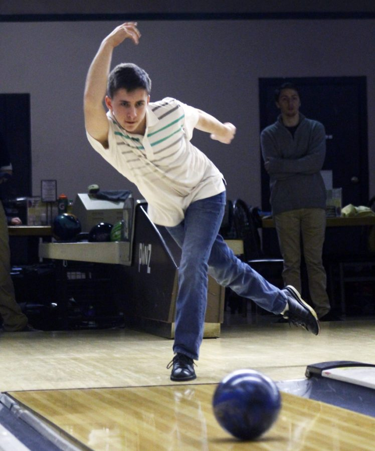 Senior Connor Thomas bowls during practice. The team practices at Pinz bowling alley off Stadium Drive. Photo Credit / Connor Wilger