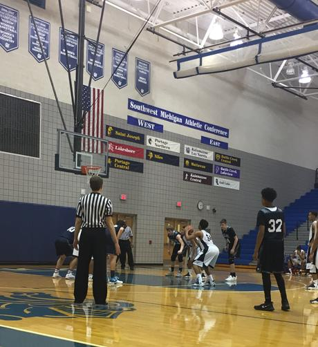 Sophomore Steffon Dunigan begins to shoot a freethrow against Gull Lake High School's varsity team. The Knights defeated the Blue Devils. Photo Credit / MaKenzie Tolin