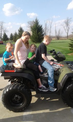 Brandon and his family hop on the ATV (all-terrain vehicle) while visiting his uncle Donny.