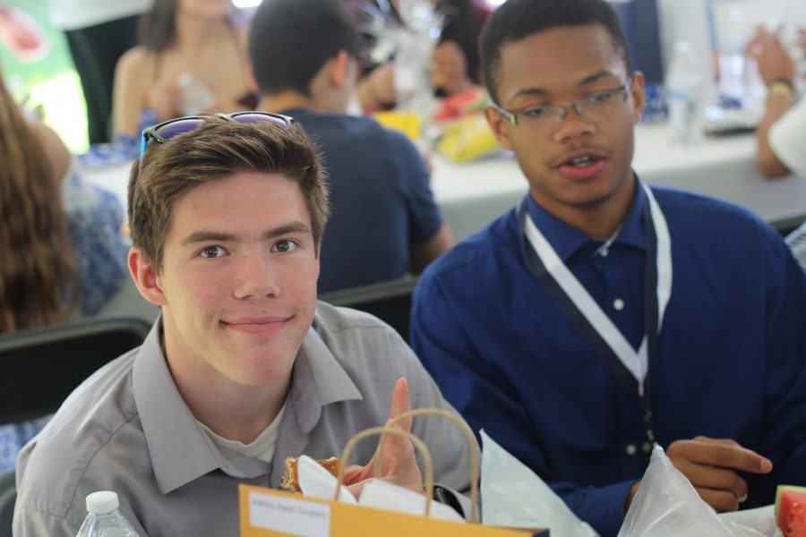 Ryan Ross and Alex Neal sit at the Candle Light lunch. They are not only thinking about the ceremony, but also their futures as a Loy Norrix graduate. Photo Credit / Bill Bowser
