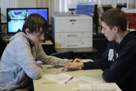 Classmates Brandon Schnurr and Hunter Sandt work on a newspaper newspaper project in Jounalism. Brandon and Hunter have known each other for about two years now and become good friends. Photo Credit / Breyana Wilson
