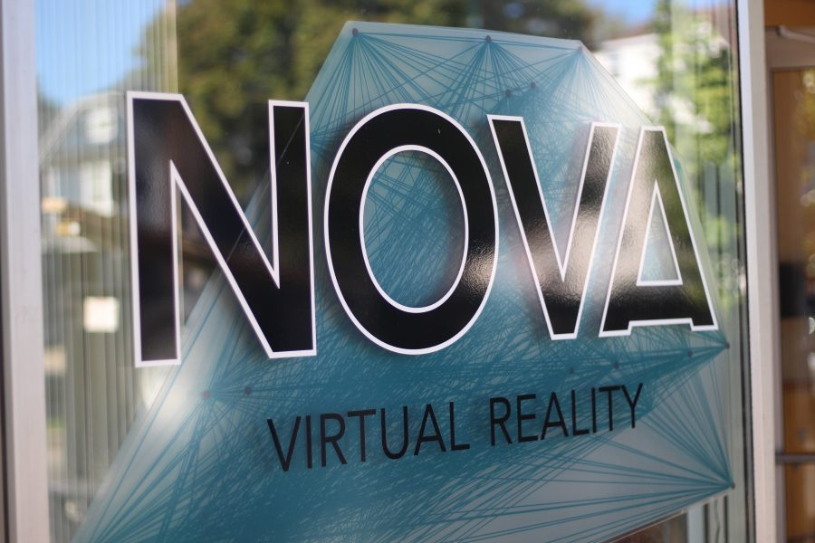 Nova Virtual Reality's logo on the window of the building. Visitors see it as they walk in.