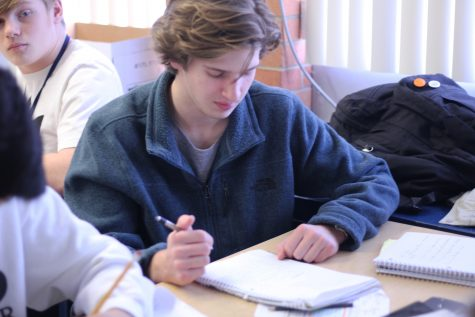 Sophomore Ben Sanford takes notes during Chemistry. Ben finds many of his classes here at Norrix enjoyable, especially when working with friends.