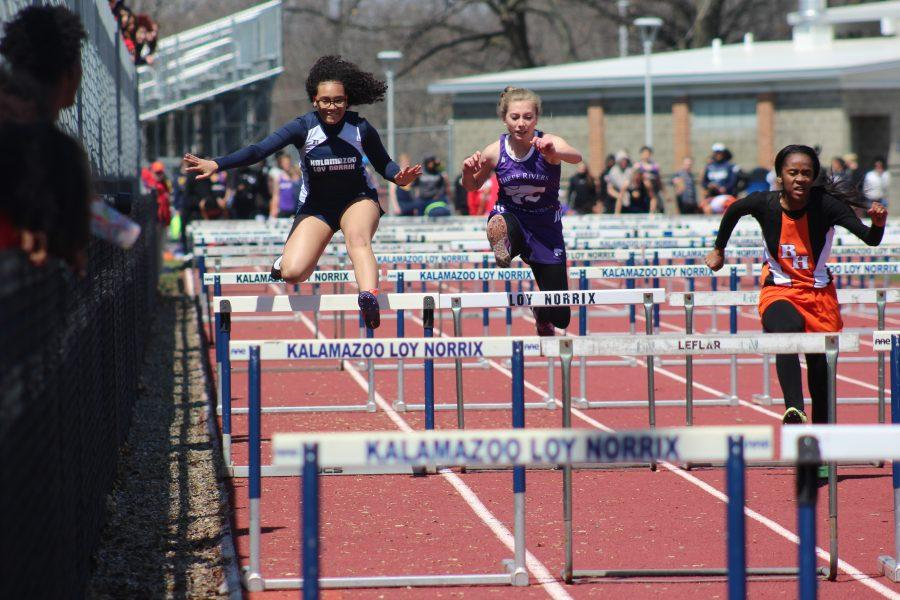 "Junior Alysia Smith leaps over in a hurdle in the 100m hurdles placing 12th place overall. ""I was trying to continue running and not laugh because someone fell next to me,"" said Smith. Photo Credit / Jaelyn Anderson"