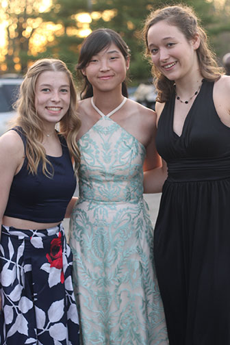 Seniors Molly Ratliff, Mey Wong, and Abby Guimond pose together for a picture. Many students met at Crane Park for pictures then parted ways for dinner.