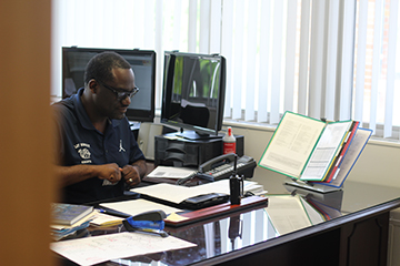 Principal Johnny Edwards reviews papers on a Tuesday afternoon. With a long week ahead, he has lots of work to do. Photo Credit / Noah Bond