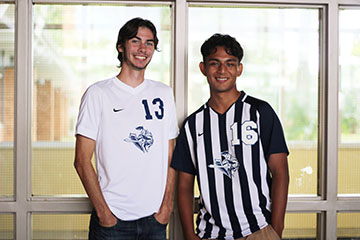 Senior Caleb Gonzales and Dustin Keltch wear their soccer jerseys to support spirit week.