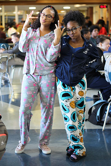 Seniors Kiara Weatherall and Alysia Smith pose together in the cafeteria during lunch.