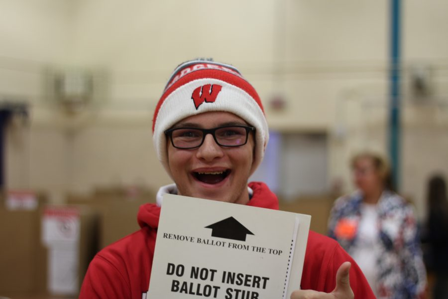 Junior+Bryce+Cooper+with+his+ballot+getting+ready+to+submit+his+votes.+Many+students+are+excited+to+experience+voting+for+the+first+time.+Photo+Credit+%2F+Gavin+Rutherford