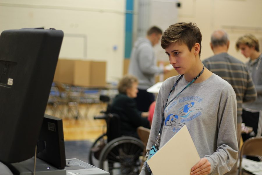 Junior Caila Chapman submitting her ballot to the tabulator. This is the last step of the voting process. Photo Credit / Gavin Rutherford