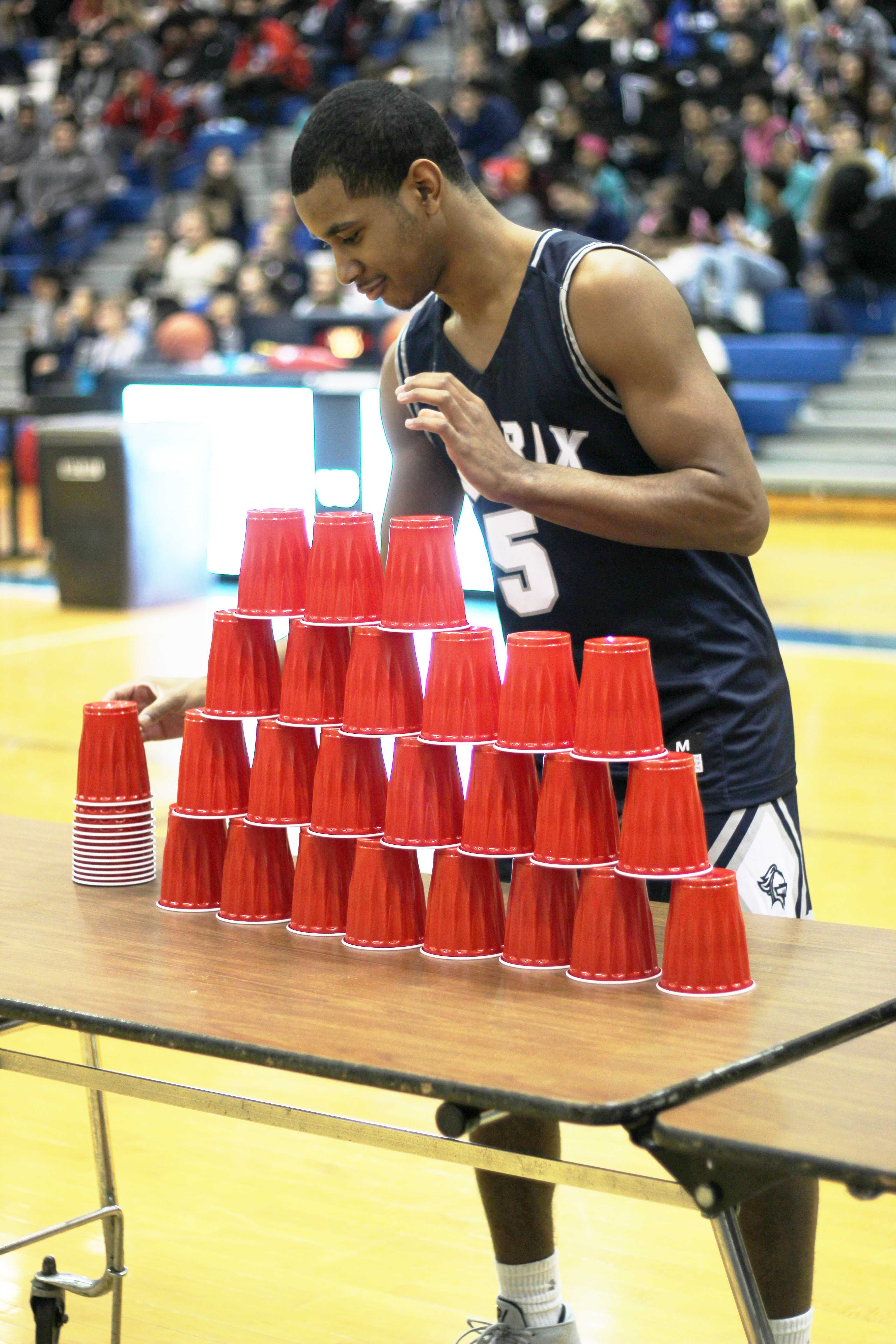 12th+grader+Kenndrel+Palmore+tries+to+stack+the+cups+as+fast+as+he+can+while+the+crowd+yells+his+name.+The+game+ended+with+him+coming+in+second+place.+