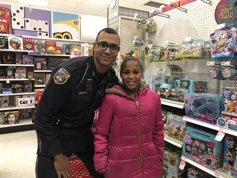 Current and Former Loy Norrix Police Officers Give Back to the Community they Serve for the Holidays