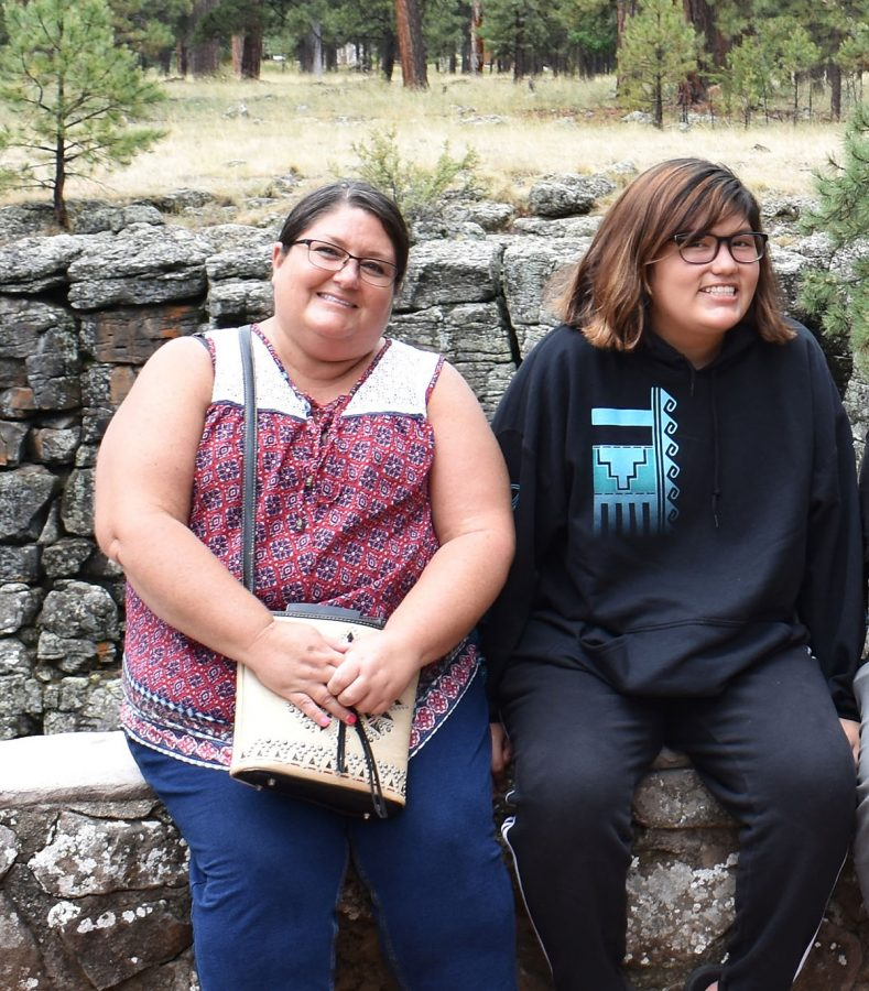 "Kalamazoo Public Schools faculty member Robin Greymountain (left) and Loy Norrix High School freshman Aanje Greymountain (right) posing at the edge of ""Assini Aglay Bigun"" in Flagstaff, AZ, during a trip back to their home in Arizona. ""Assini Aglay Bigun"" is a sacred mountain in Navajo culture, and the location where Aanje Greymountain and her sister NaMe Greymountain (not pictured) were born."