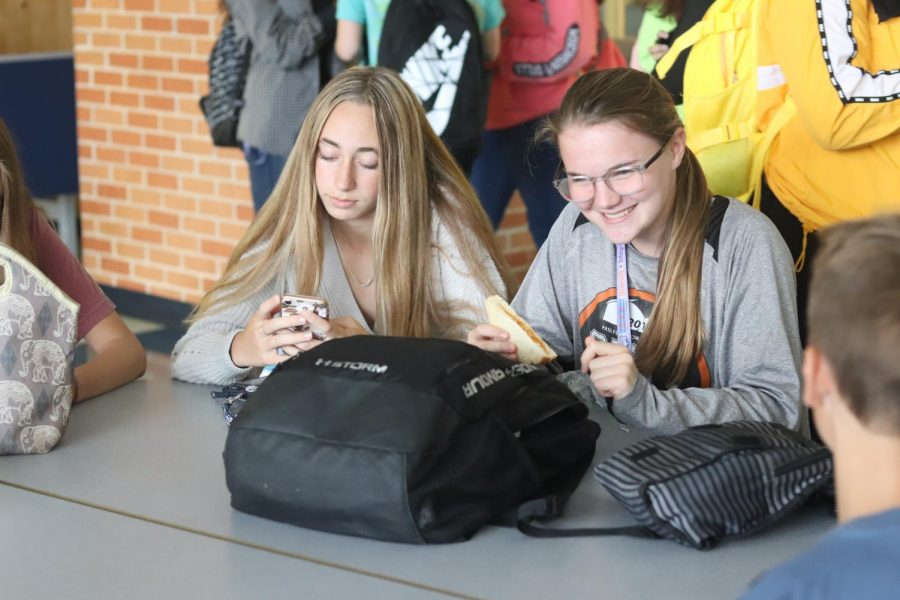 Freshman Nina Molitor and Hannah Locke enjoy eating lunch in the cafeteria. After morning classes some social time with friends is much needed.