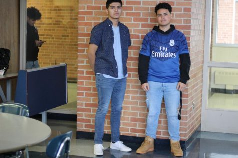 Seniors Carlos Santos and Alan Adunas show off their clothes in the cafeteria. Many students try to dress well to impress their peers.