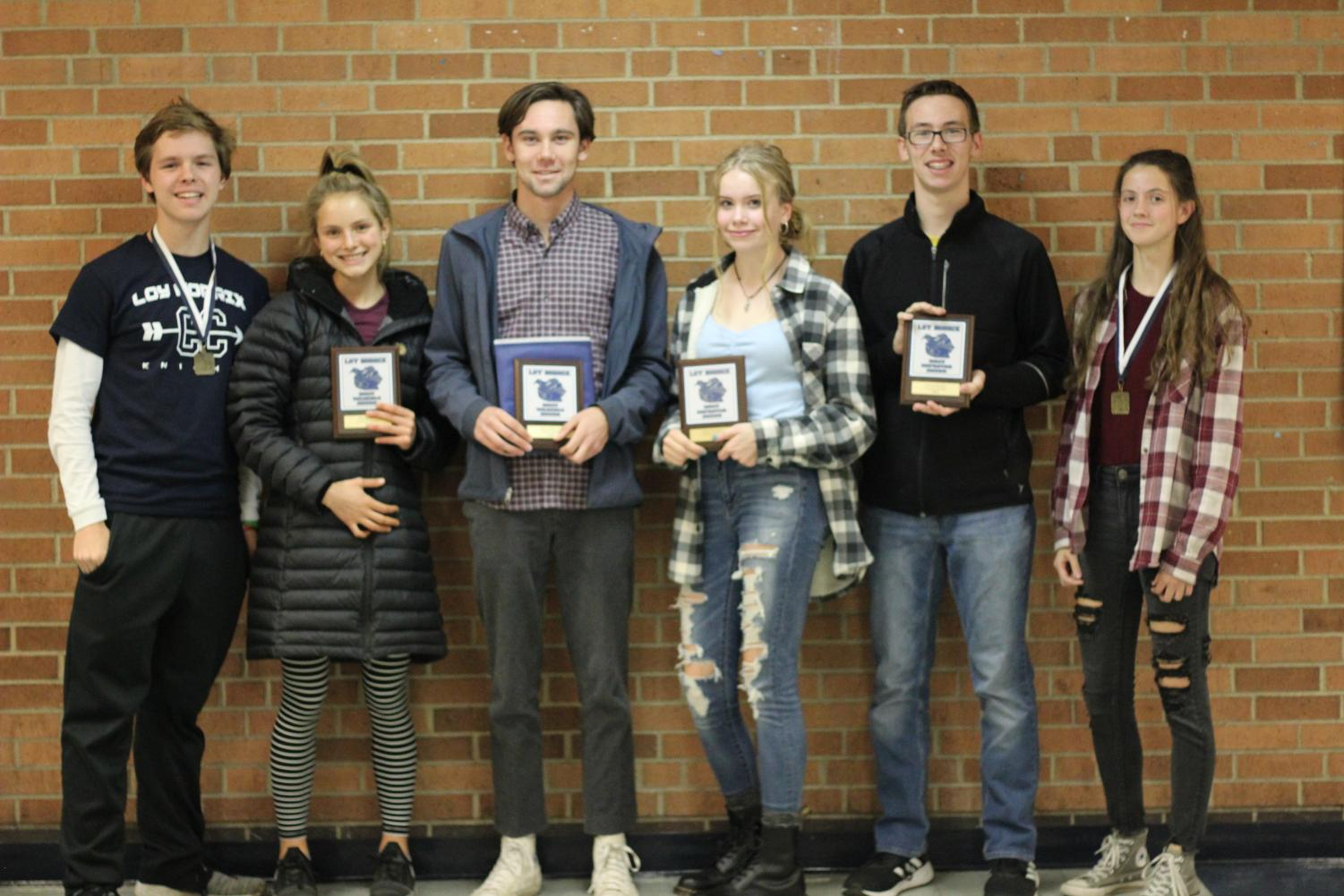 From left to right, junior Keegan Hughes, seniors Ella Schnell and Jozef Meyers, sophomores Lillian Daniels and Gavin Rozanc, and junior Kinsey Skjold pose for a photo after receiving their awards at the cross country awards ceremony. Hughes and Skjold received the sportsmanship award, Meyers and Schnell won the MVP award, and Daniels and Rozanc won the most improved award. Photo Credit / Colin Carnell