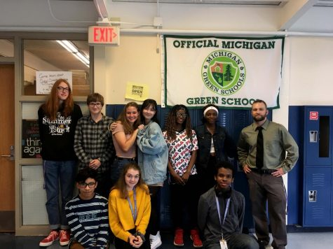 LNHS Green School Club members gather in front of Green School flag after meeting. Green Club meets every Thursday to discuss environmental issues and maintain a green school.