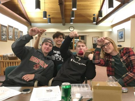 Left to right: Maxwell Spitler, Eli Wiitala, Tanner Peterson, and Maggie Staub hold up fishing lures made during the second day of the meeting. The entire meeting lasts three days and covers multiple topics.