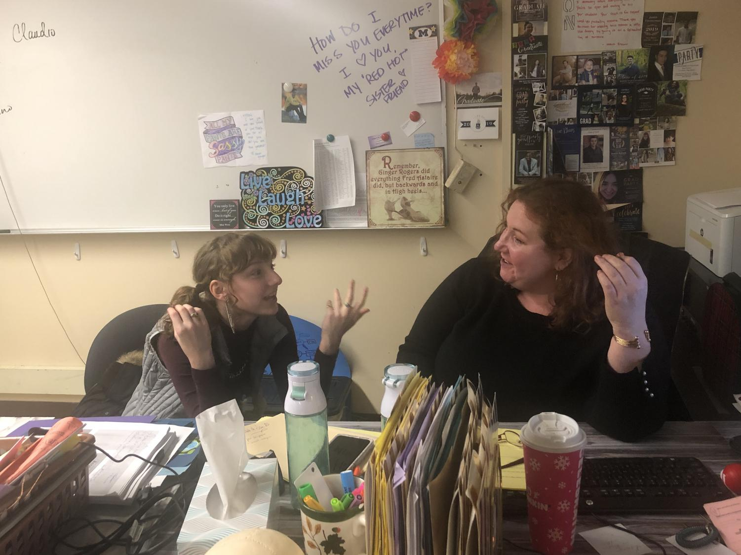 Senior Emma Hilgart-Griff and teacher Rebecca Layton discuss the womens studies curriculum. The class is a mix of political science, psychology and womens history.
