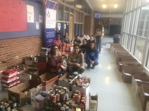 PeaceJam members pose with food drive haul in the B-wing. Members pictured are Laya Houslander, Carlos Morales-Amates, Melissa Preston, Anna Sankey, Kim Chheu, Tanner Klute, Cecilia Mireles-Caballero, Samantha Schaffer, and Annaliese Bol.