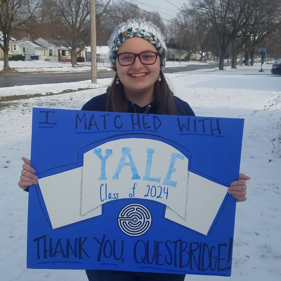 Senior Lily Dorstewitz poses with her Questbridge poster after learning of her acceptance to Yale.