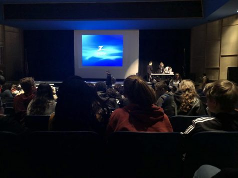 Freshmen Yacine Lo and Mara Vander Beek wait for the movie to start during the assembly. Lo and Vander Beek both had 3.5 GPAs and enjoyed the assembly.