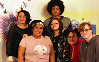 Aside from Darien Burress and Dana Hudson, all pictured made it onto Fire's slam poetry team and will be going to Louder Than A Bomb in Detroit from May 1 to May 3. From left to right. Back row: freshman Mary Besser and former Loy Norrix student Mike Cobbs. Middle row: sophomore Briana Jean-Baptiste, Lex Rose, attendee Darien Burress and senior Colin Carnell. Front row: Fire staff member Dana Hudson and former Loy Norrix student Ariana Reece. Photo Credit / Amara Monae