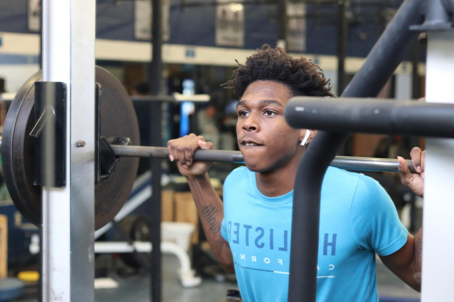 Junior Ja'Mari Jackson works out in the Loy Norrix weight room to start the New Year off right. Jackson plans on continuing to workout throughout the year.