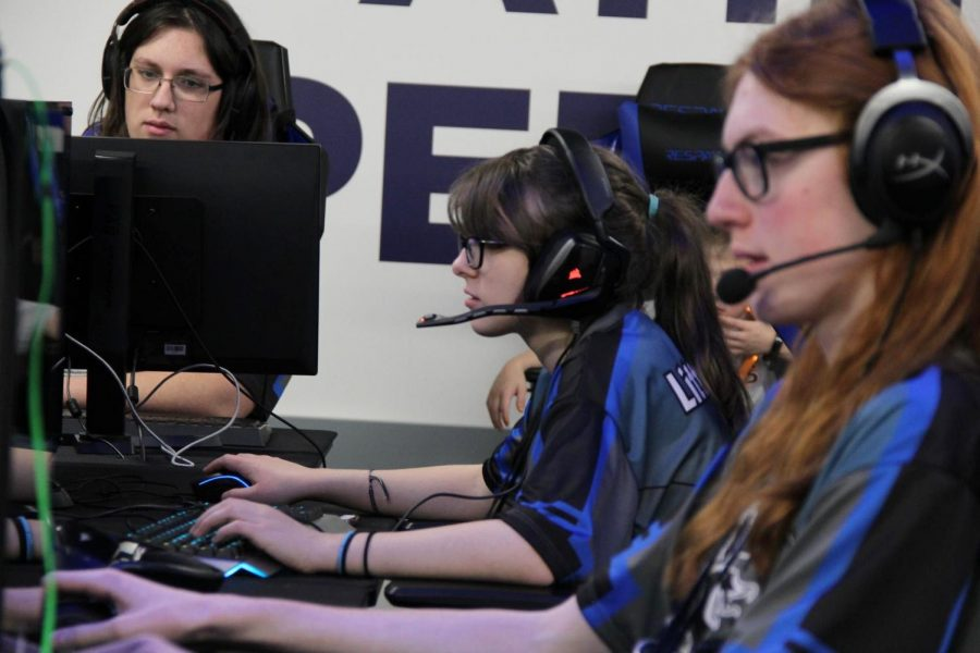 Junior Sophie Decker and other members of the Overwatch team are shown playing Overwatch. They are competing at the 2019 esport MiHSEF finals in Midland, Michigan.
