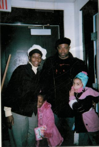 Left to right front row, Yvonne Robinson's grandmother Brenda Hendricks and her father Rodney Robinson. Left to right bottom row, her cousin Issys Robinson, and Yvonne Robinson. Yvonne and her family are pictured before serving hundreds of homeless people at a mission located in Detroit, Michigan. This photo was taken about a month before Yvonne's father, Rodney Robinson passed.