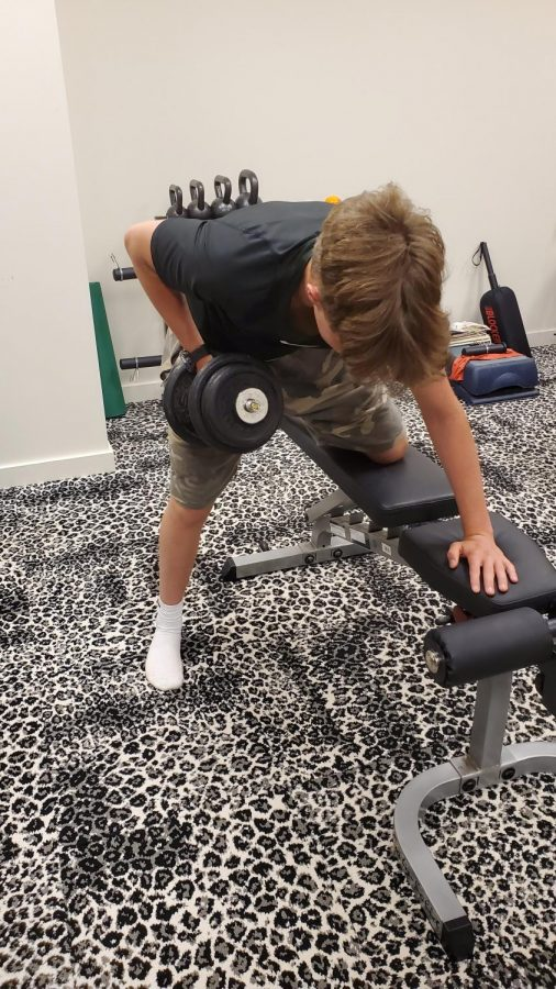 Sophomore Ian Woodruff performs a 'row'. Rows are commonly found in upper body workouts.