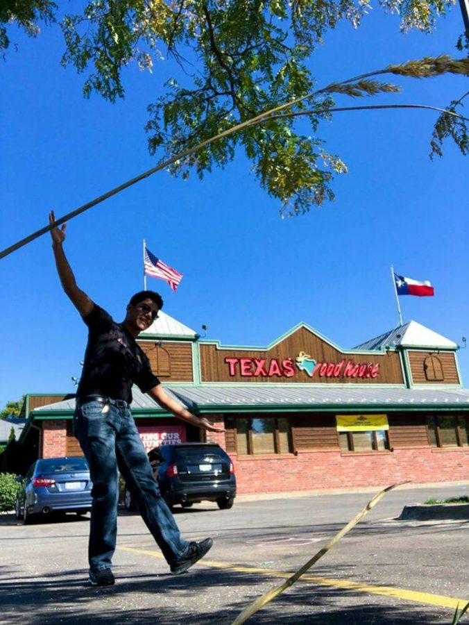 LN senior Carlos Morales outside Texas Roadhouse. He works there as a busser and host.